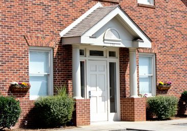 Just minutes from Charlotte, out outpatient treatment center is conveniently located near I-485 and I-74 and tucked away on a quiet and private street. Our goal is to provide our clients a warm, nurturing, and safe environment to heal. Our facility features inspiring art, soothing colors, and comforting surroundings.